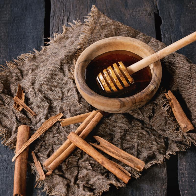 Cinnamon sticks and honey pot
